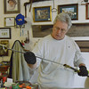 Globe/Roger Nomer<br /> Steve Bolek examines a Civil War sword at SACS 66 on Friday morning.