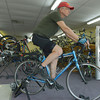 Globe/Roger Nomer<br /> John Robb rides a trainer at TailWinds Bike Shop in Pittsburg on Thursday.