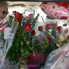 Globe/Roger Nomer<br /> Joyce Carpenter, left, and Karen Eubanks look for precious space in their vehicle to fit one more arrangement as they make flower deliveries for Higdon Florists on Thursday.