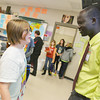 Globe/Roger Nomer<br /> Kodi Taylor, sixth grade, talks with Manon Bol following his presentation at Pittsburg Middle School on Thursday.