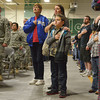 Globe/Roger Nomer<br /> (from left) Connie Holt, Mary and Gage Lawson, 9, Galena, stand for the National Anthem during the deployment ceremony for the 276th Engineer Company on Monday at Pierce City High School.