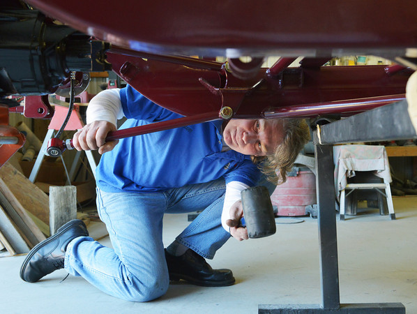 Globe/Roger Nomer<br /> Barry McGill works on the back end of a 1934 Ford Coupe replica kit in his garage in Granby on Monday.