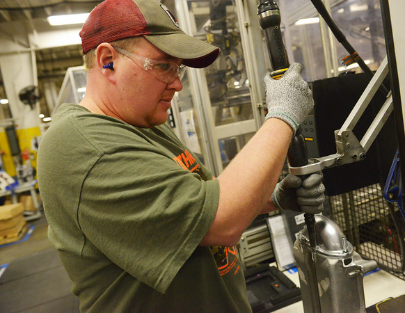 Globe/Roger Nomer<br /> Jeff Freeman uses a torque tool at Modine Manufacturing on Wednesday.