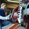 Globe/Roger Nomer<br /> Barry McGill works on the back-end shocks of a 1934 Ford Coupe replica kit in his garage in Granby on Monday.