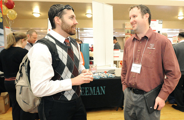 Pittsburg State University junior Rocky Davied, left, talks Thursday with Larry Nichols, of Missouri State University about the Masters of Business Administration program at MSU. Davied was attending the PSU Career Fair. which featured about 90 businesses and educational institutions.<br /> Globe | Laurie Sisk