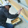 Globe/Roger Nomer<br /> Jodeob Cogbill, with the Jeff Neal Group, paints a building near 6th and Main on Tuesday morning.
