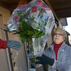 Globe/Roger Nomer<br /> Glenda Green carefullly takes an arrangement for delivery from Higdon Florists on Thursday.