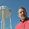 Globe/Roger Nomer<br /> Backed by cell phone towers on the water tower, Carl Junction City Administrator Steve Lawver talks about cell phone towers on Thursday afternoon.