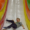 Globe/Roger Nomer<br /> Elijah Busse, 6, Carl Junction, tackles a slide at the newly-reopened House of Bounce on Monday morning. The inflatable fun center has reopened for business following a fire last year.