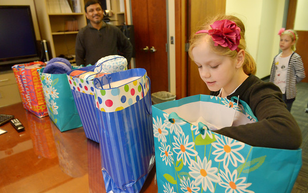 Globe/Roger Nomer<br /> Molly Waters, 10, shows her birthday donations to Boban Mathew, medical director at the Via Christi Cancer Center, on Friday.