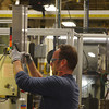 Globe/Roger Nomer<br /> Jeff Pugh inspects an EGRC core at Modine Manufacturing on Wednesday.