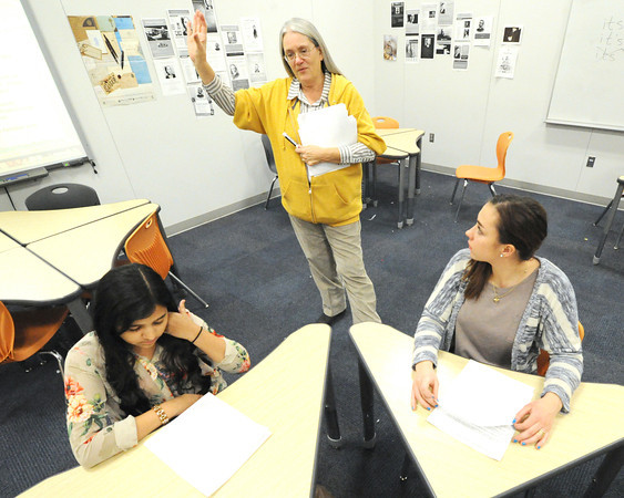 Joplin High School teacher Brenda White, center, offers tips for success while taking the ACT exams to JHS juniors Nazhath Sulthana, left and Breana Deweese during an ACT prep class on Friday at the school.<br /> Globe | Laurie Sisk