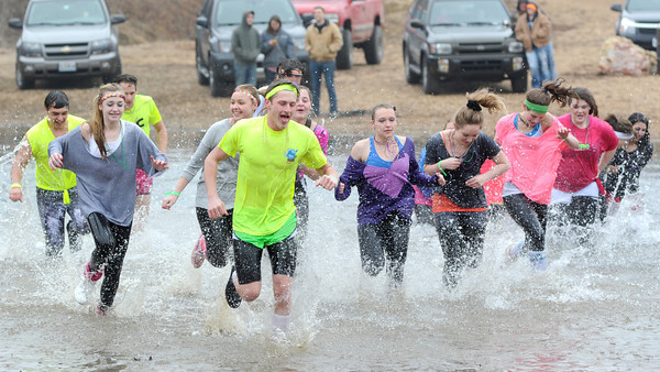 A large group from Carl Junction High School braves the chilly waters of Shoal Creek on Saturday afternoon as part of the Polar Plunge. The event was a fundraiser for Special Olympics and involved 63 plingers.<br /> Globe | Laurie Sisk