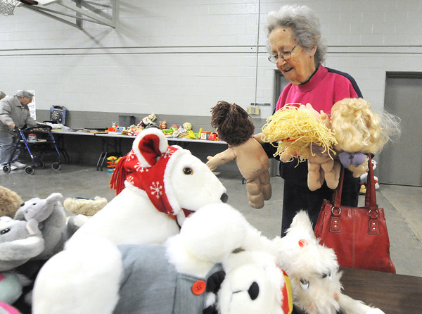Shirley Lamb, of Joplin, smiles after finding three cabbage patch dolls to add to her collection after perusing items on Saturday at the Annual Cabin Fever Rummage Sale at The National Guard Armory. Proceeds from the event go to benefit  the 203rd Retirees Association.<br /> Globe | Laurie Sisk