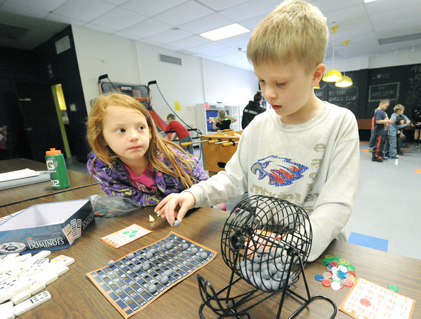 Six-year-old Jesslynn Ugalde, left and seven-year-old Bradon Beerly play Bingo during the recreation program at the Joplin Boys and Girls Club afterschool program on Friday.<br /> Globe | Laurie Sisk
