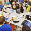Globe/Roger Nomer<br /> Manon Bol talks with a group of sixth graders over lunch at East Middle School on Thursday.