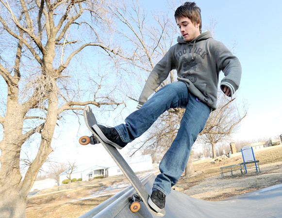 Dakota Lee takes advantage of milder temperatures on Wednesday afternoon as he perfects his skateboard skills at the Joplin Skate Park in Schifferdecker Park.<br /> Globe | Laurie Sisk