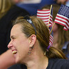 Globe/Roger Nomer<br /> Debra Phillips, Mt. Vernon, decorates her hair with American flags in support of the 276th Engineer Company on Monday. Phillips is a family friend of a member of the 276th.