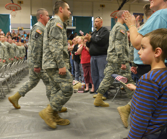 Globe/Roger Nomer<br /> Jaden Carter, 6, Cassville, waves a flag as the 276th Engineer Company departs from Pierce City High School on Monday. Carter's uncle is in the 276th.