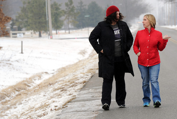 Sammie Brueggemann, left and Joanna Rhodes walk along an area of road where some Pittsburg residents hope a multi-purpose trail will be built. Both women cite safety concerns and a need for connectivity to an existing walking trail on Centennial Avenue as a reason for the trail.<br /> Globe | Laurie Sisk