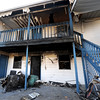 Debris from a Tuesday night fire at Collegeview Apartments, 3804 CollegeView is visible Wednesday. One man was critically injured in the blaze.<br /> Globe | Laurie Sisk