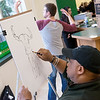 Globe/Roger Nomer<br /> Butt sketch artist Krandel Lee Newton sketches Christopher Tucker, a Missouri Southern freshman from Joplin, at the Billingsly Student Center on Wednesday. Newton is a nationally renown butt sketch artist on tour, and his work has been featured in numerous newspaper articles and on the Jimmy Kimmel Show.