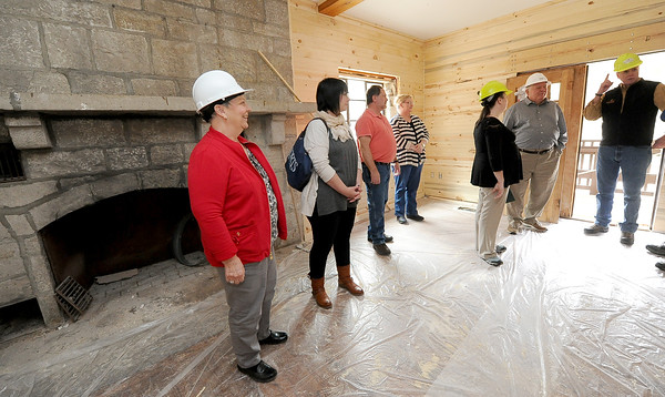Park employees watch as renovations continue on the Civilain Conservation Corps Lodge at Roaring River State Park last Friday. The lodge, which was completed in 1938, has not rented out guest rooms since the 1970s.<br /> Globe | Laurie Sisk
