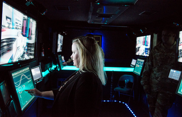 Maghan Alberts, veterans services coordinator at Missouri Southern, tries out a simulation in the U.S. Army STEM Truck on Monday on campus.