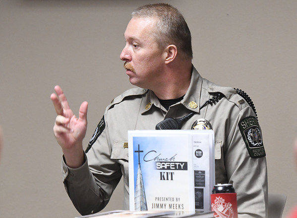 Newton County Deputy J.T. Williams answers questions during a seminar on church safety on Tuesday afternoon at New Mac Electric in Neosho. About 40 people attended the seminar.<br /> Gobe | Laurie Sisk