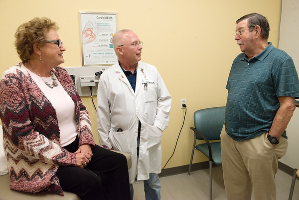 William Craig, cardiologist and director of cardiovascular services, talks with patients Amy and Lewis Broooks on Monday at Mercy Hospital.<br /> Globe | Roger Nomer