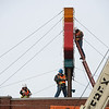 Workers prepare the Wilder's Restaurant sign for removal on Friday in Joplin.<br /> Globe | Roger Nomer