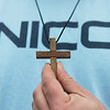 Sean Nicodemus has kept a wooden cross from Spencer's room, made by Spencer's grandfather for his baptism.<br /> Globe | Roger Nomer