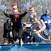 From the left: Carthage Police Department officers Netisha Mora and Trevor Hole take the chilling plunge into 48 degree water during the Special Olympics Polar Plunge on Saturday at the Joplin Elks Lodge.<br /> Globe | Laurie SIsk