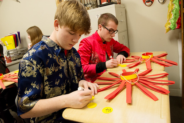 Colton Henkle, left, and Preston Johnson, Thomas Jefferson Independent Day School sophomores, write their wishes for the Chinese New Year to decorate lanterns on Friday.<br /> Globe | Roger Nomer