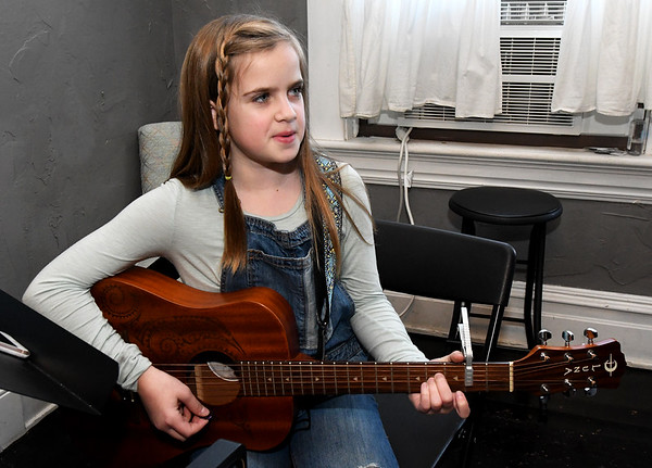 "Ten-year-old Emme Rogers practices her anti-bullying anthem, ""Stand Up,"" during lessons with instructor Kacey Baugh-Lee on Tuesday at Maple Leaf Music Company in Carthage. Rogers said she wrote the song after she noticed kids at school being bullied.<br /> Globe 