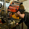 From the left: PSU Baja's Drew Harmon and Camden Mylott work on the rear suspension of their buggy on Wednesday night at PSU. Members wil spend more than 2,500 hours getting their vehicle ready for competition.<br /> Globe | Laurie Sisk