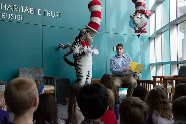 The Cat in the Hat and Adam Fahrenholtz, medical director of hospitalists at Freeman Health System, read a Dr. Seuss book to first graders from Thomas Jefferson Independent Day School at Freeman West on Friday. The visit was organized with Ozarks Public Television.<br /> Globe | Roger Nomer
