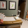 The new medical exam room at the Children's Center also has shower and laundry facilities.<br /> Globe | Roger Nomer