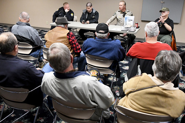 Reoresentatives from both the Neosho Police Department and the Newton County Sheriffs Department address the issues surrounding church safety during a seminar on Tuesday afternoon at New Mac Electric in Neosho. About 40 people attended the seminar.<br /> Gobe | Laurie Sisk