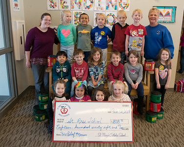 Students in April Englebert's afternoon Pre-K class pose with a check in the amount to be sent to St. Rose School on Monday at St. Mary's Elementary. The morning and afternoon Pre-K classes raised the most in the school.