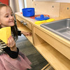 Five-year-old Anna Pennock, of Galena, exercises her culinary creativity while playing in the toy kitchen on Thursday at the Joplin Public Library.<br /> Globe | Laurie Sisk