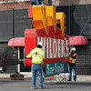 Workers prepare to load the Wilder's Restaurant sign onto a truck on Friday.<br /> Globe | Roger Nomer