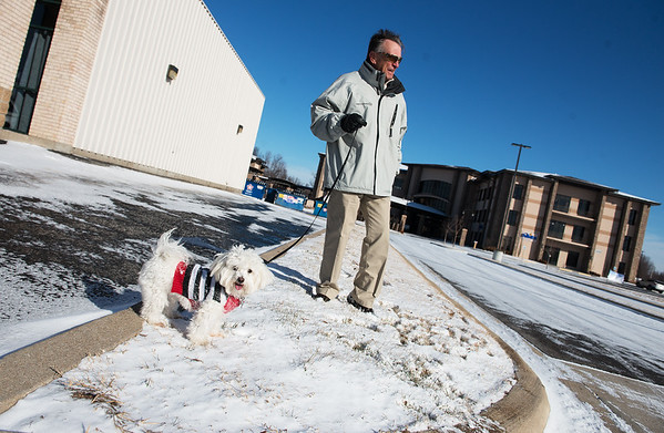 Jerry Blight takes his dog Salty out for a walk on Monday.<br /> Globe | Roger Nomer