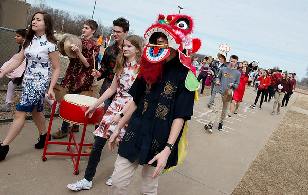 Wearing a dragon head, Jax Palmer, Thomas Jefferson Independent Day School freshman, helps lead a parade on Friday in celebration of the Chinese New Year at the school.