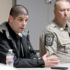 Newton County Detective Brad Black speaks about the importance of having a plan and making sure all involved are on the same page as Newton County Deputy J.T. Williams looks on during a seminar on church safety on Tuesday afternoon at New Mac Electric in Neosho. About 40 people attended the seminar.<br /> Gobe | Laurie Sisk