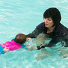 Leslie Harrison, owner of SuperStar Aquatics, helps Landry Blackledge, 1, swim underwater at the Joplin YMCA pool on Wednesday.<br /> Globe | Roger Nomer