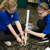 Morgan Hughes, left, and Victoria Kohley, seventh graders at Carl Junction Junior High, construct an engineering solution on Friday at the Regional TSA Conference at Missouri Southern.<br /> Globe | Roger Nomer