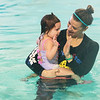 Shannon Schultz, of SuperStar Aquatics, gives Madelyn Borok, 2, a high five for her swimming effort on Wednesday at the Joplin YMCA pool.<br /> Globe | Roger Nomer
