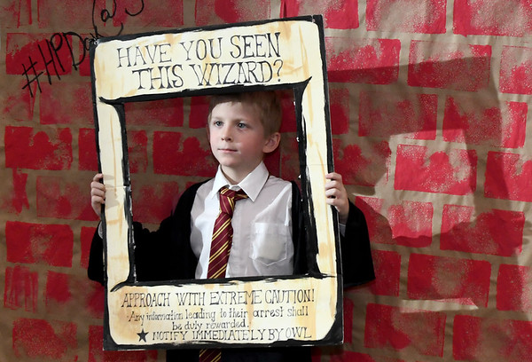 Eight-year-old Edward Seavy pauses in the middle of a scavenger hunt to have his picture taken during Harry Potter night on Friday at the Joplin Public Library.<br /> Globe | Laurie Sisk