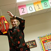 Luke Goodhope, Thomas Jefferson Independent Day School sophomore, hangs a Chinese latern for celebration of the Chinese New Year during class on Friday.<br /> Globe | Roger Nomer